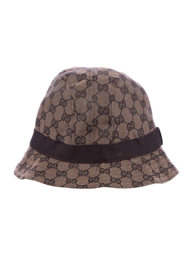 brown and black gg canvas bucket hat with black trim and gold tone logo plate. Black Bedroom Furniture Sets. Home Design Ideas