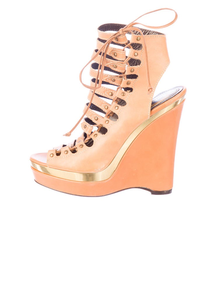 leather wedges with gold tone trim at uppers bronze