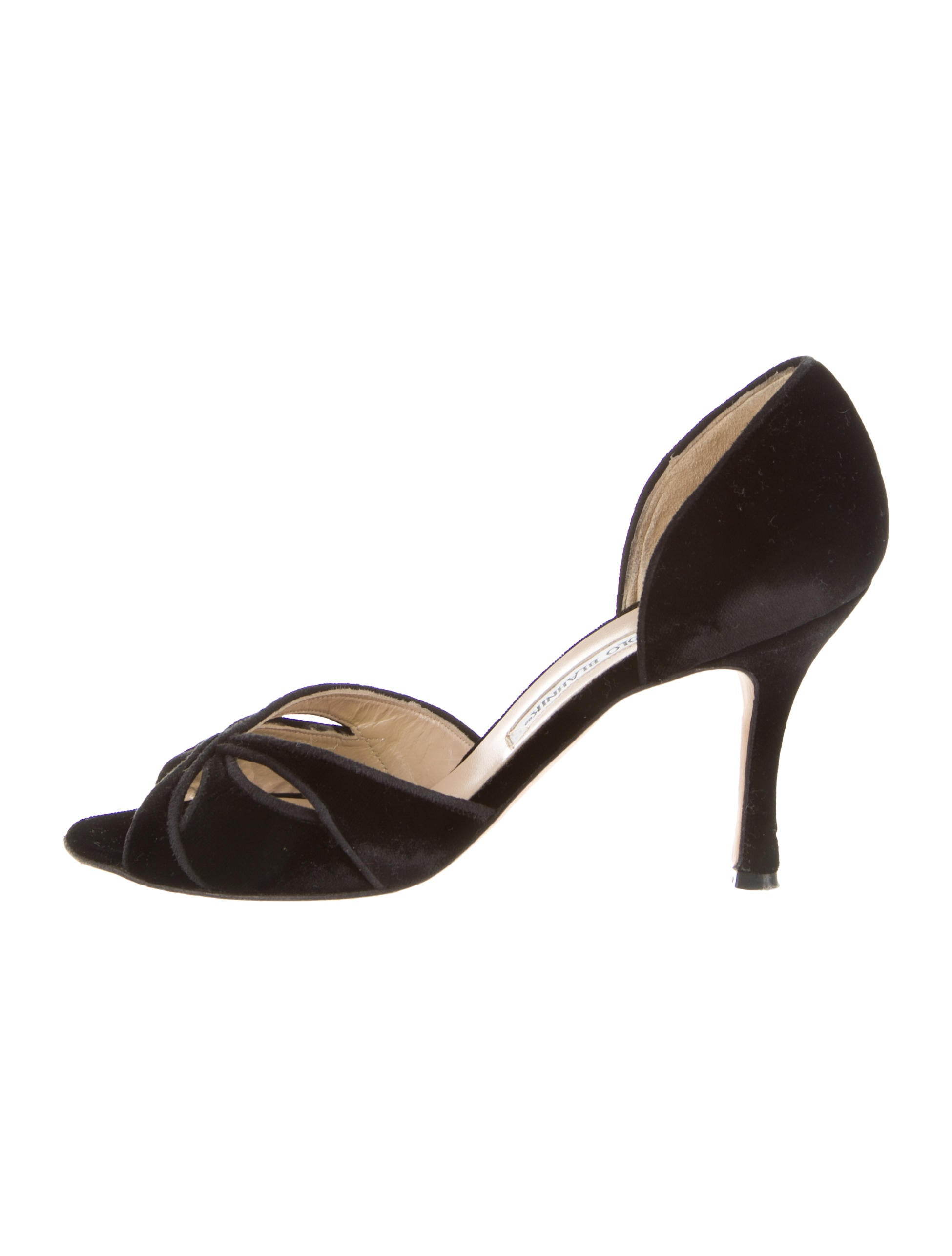 a two-tone pump crafted with sleek patent leather, slip-on styling, a logo plaque heel tab and a pointed toe in a d'orsay style.