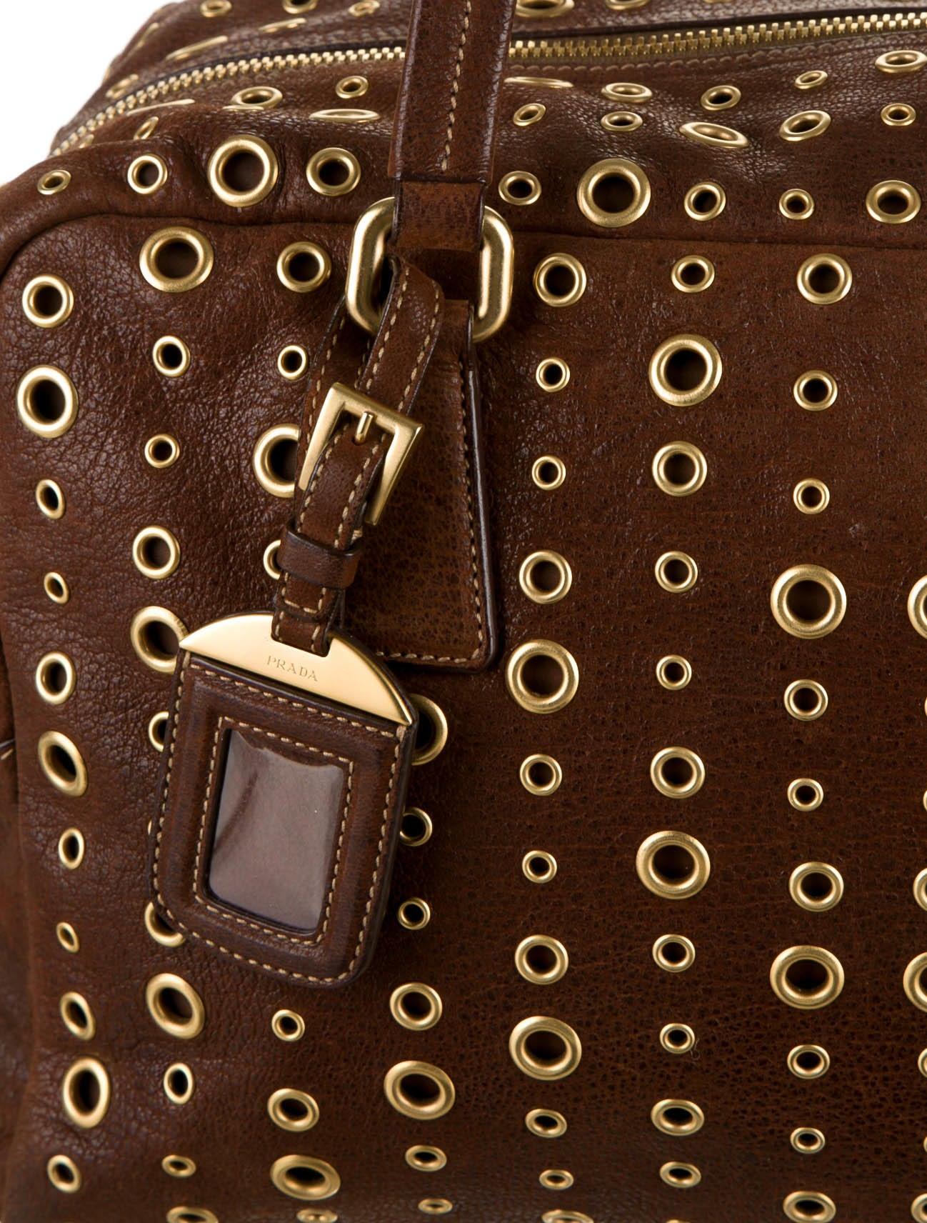 prada grommet-accented bag
